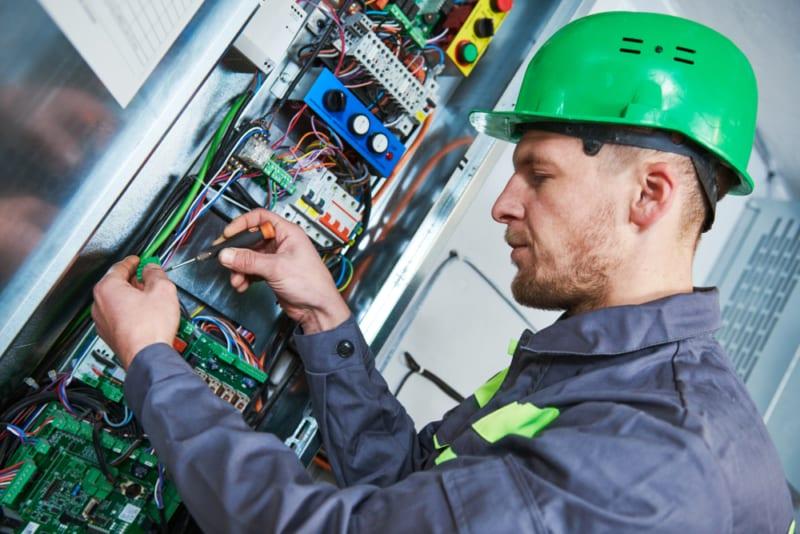 Lift engineer working on electrics